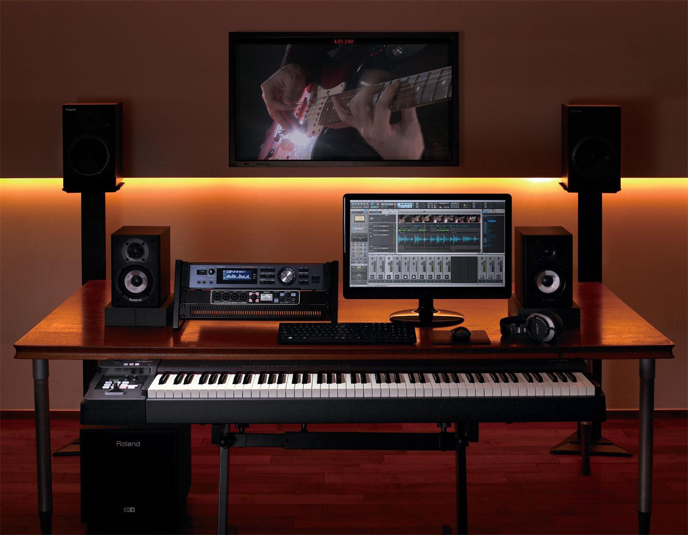 computer setup with piano